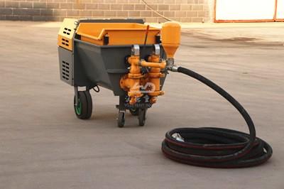 Mortar spraying machine for building application