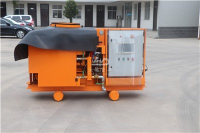spraying concrete machine in tunnel for protect